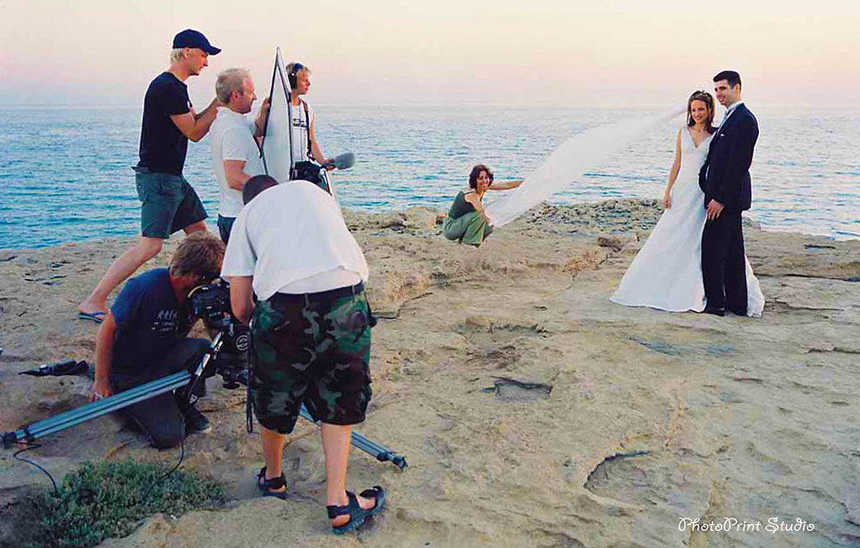 Groom and Bride outdoors at the Cape Greco beach, the magnificent Mediterranean Sea in the background