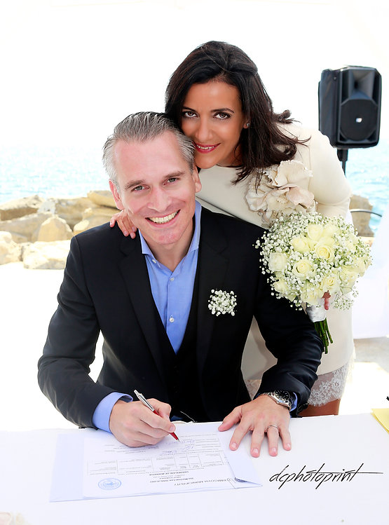 Groom signing marriage license on wedding contract  at  Amathus Beach Hotel, Limassos cyprus | best wedding venue limassol, city hall Limassol wedding photography cyprus