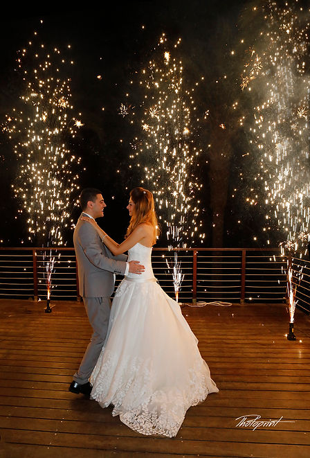 Newly married couple dancing on their wedding party background heavy beautiful fireworks with lots of stars | wedding portfolio