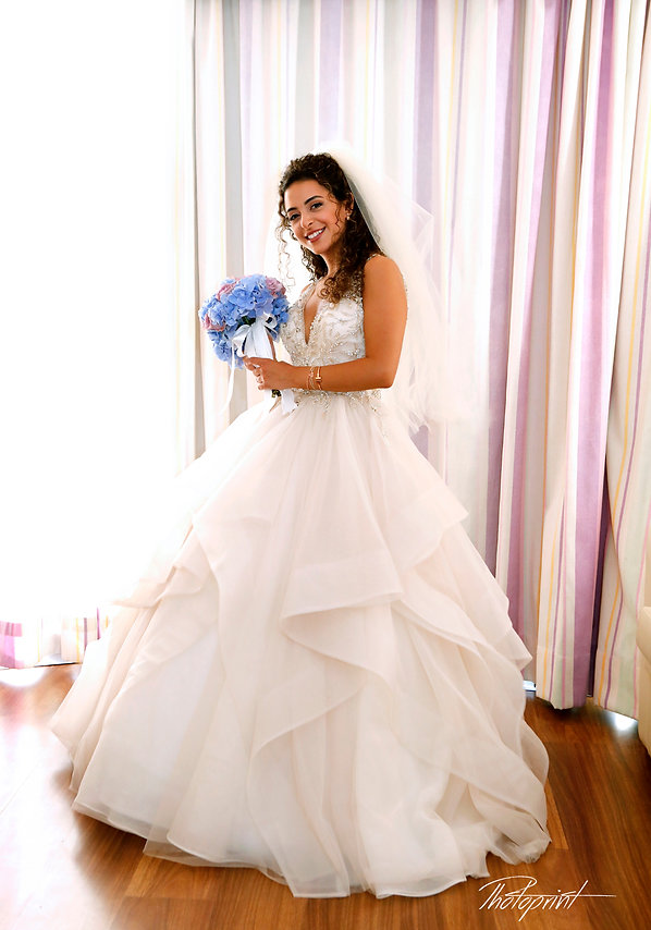 Happy brunette bride Close-up portrait of gorgeous beautiful bride in white dress with amazing hair style and make up, with bouquet of flowers   Civil Ceremonies larnaca Cyprus, larnaca wedding venues photographer prices,larnaca wedding venues