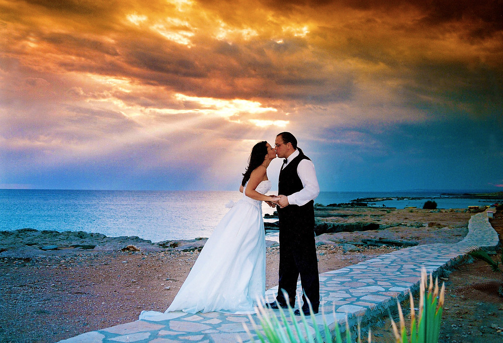 Beautiful and gentle wedding photo session outdoors of the elegant couple, romantic portrait.