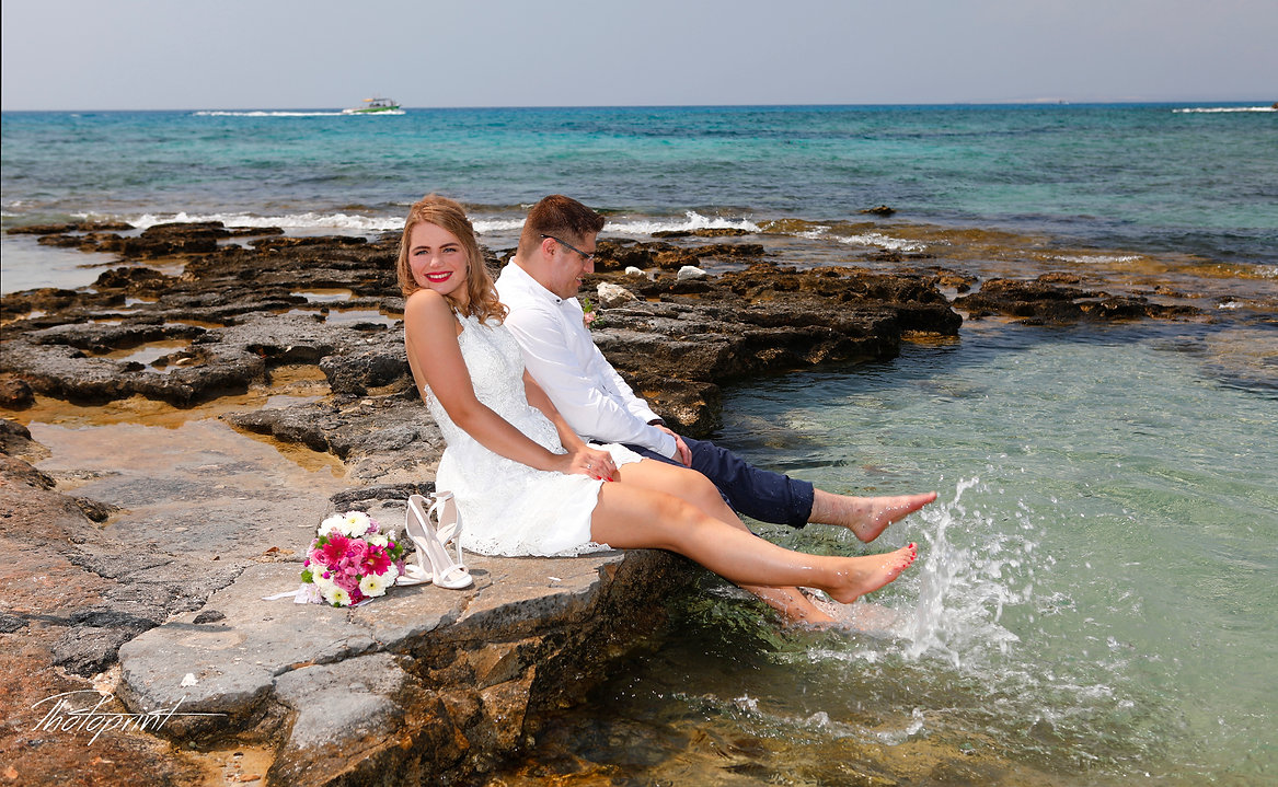 Fine art photo of an attractive wedding couple,blue Mediterranean Sea on background | ayia napa cyprus beach wedding, ayia napa cyprus beach weddings, ayia napa  cyprus images wedding photography