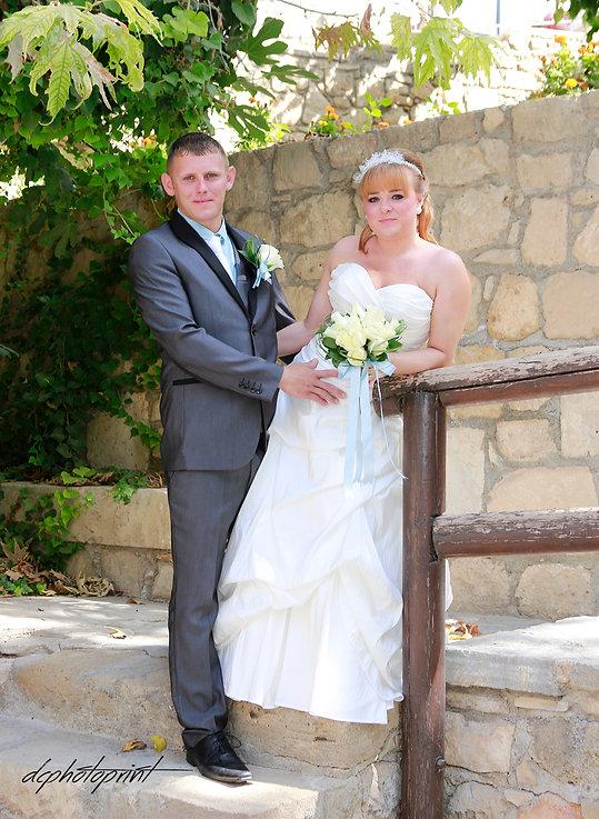 Elegant smiling bride and groom walking on the garden | cyprus wedding photo, wedding photographers cyprus