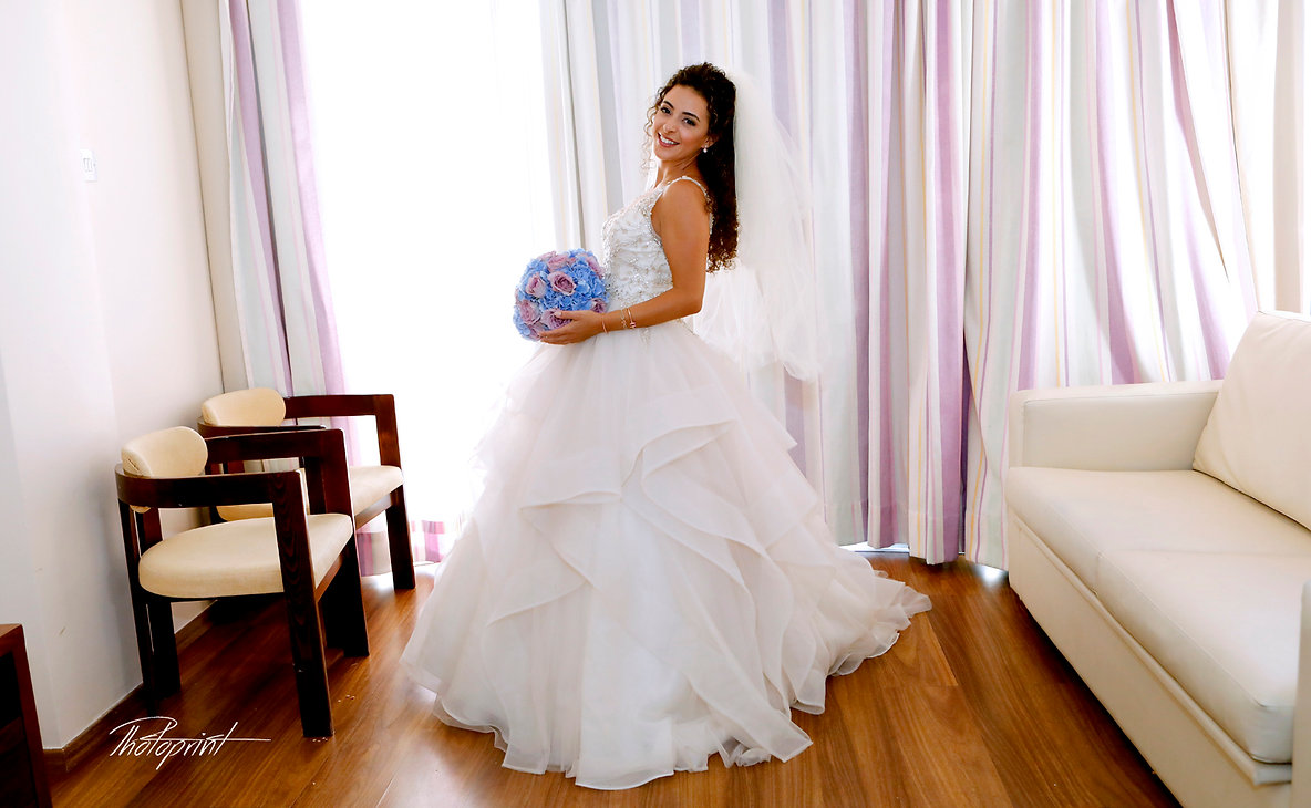 Happy brunette bride Close-up portrait of gorgeous beautiful bride in white dress with amazing hair style and make up | Beach Weddings Packages larnaca, wedding photographers in larnaca cyprus, wedding photographer larnaca