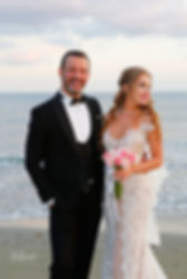 Beautiful and gentle  wedding photo session outdoors of the elegant couple (bride in a white dress with veil holding a bouquet and groom in the classic tuxedo costume) | best wedding venues larnaca