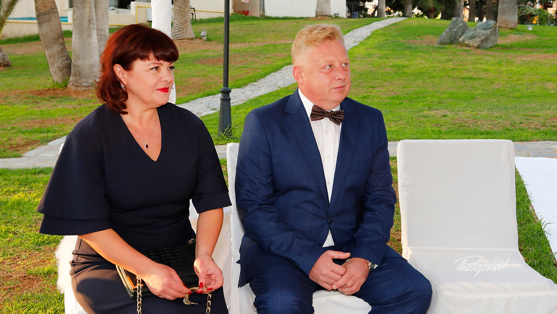 Yuliia Vasina's Father and mother at her Wedding ceremony in the garden of Golden Bay Beach Hotel, Larnaca | Beach Weddings Packages larnaca, Cyprus Weddings in Larnaca, Civil ceremony at Larnaka town hall
