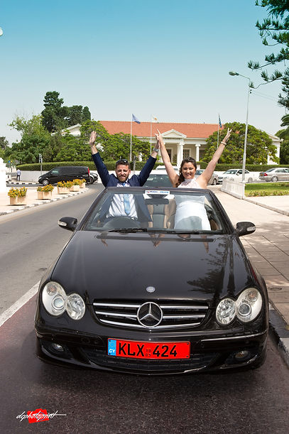 Wedding couple hugging in car | sraeli  best wedding photographers in ayia napa cyprus, wedding photographer in paphos israeli