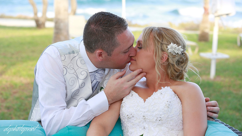 bride and groom Kissing outdoors at Pernera beach Hotel, Protaras cyprus  | cyprus wedding photographers protaras, wedding photographers protaras cyprus