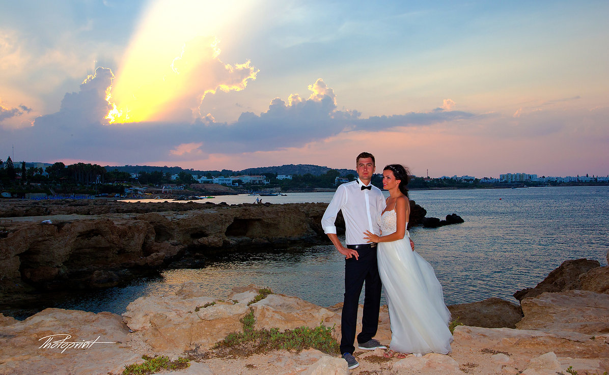 Beautiful wedding couple walking on beach at sunset holding hands | Bespoke wedding pictures ideas in Protaras cyprus, budget wedding photographers Protaras cyprus