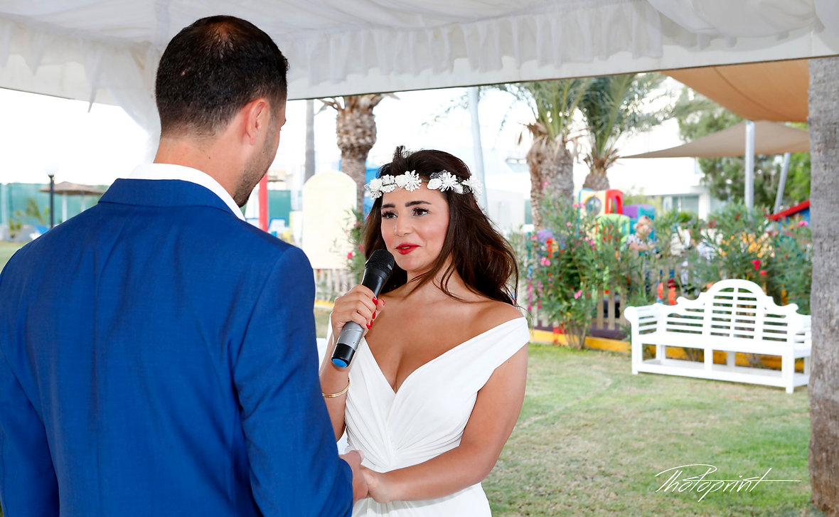 Beautiful Bride swearing lifetime loyalty during the wedding ceremony  in Golden Bay Beach Hotel, Larnaca | cyprus wedding photography larnaca, wedding larnaca photographers photography