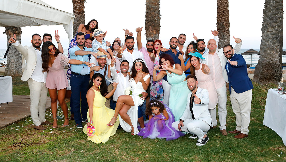 Happy Wedding guests with the newlyweds celebrating |  wedding in Larnaca municipality, Larnaca wedding photography venues
