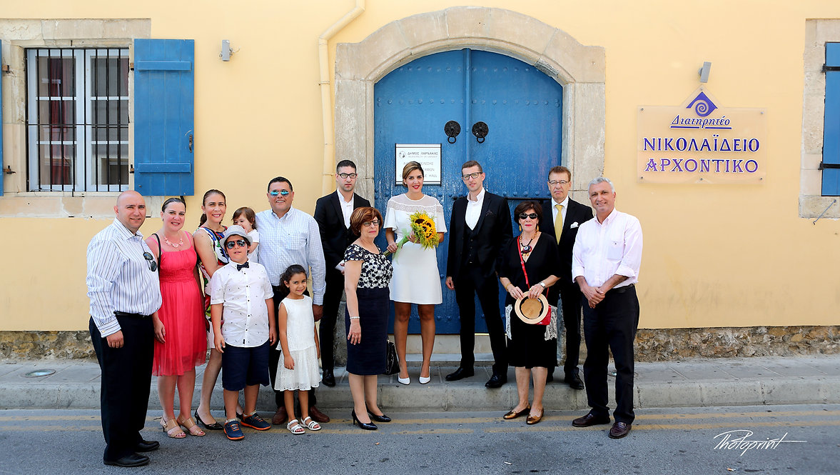 Photo outside the Larnaca municipal Town Hall with Rabih and Zeina and all the guests from Lebanon before the wedding | city hall larnaca wedding photography cyprus, cyprus wedding photographers larnaca