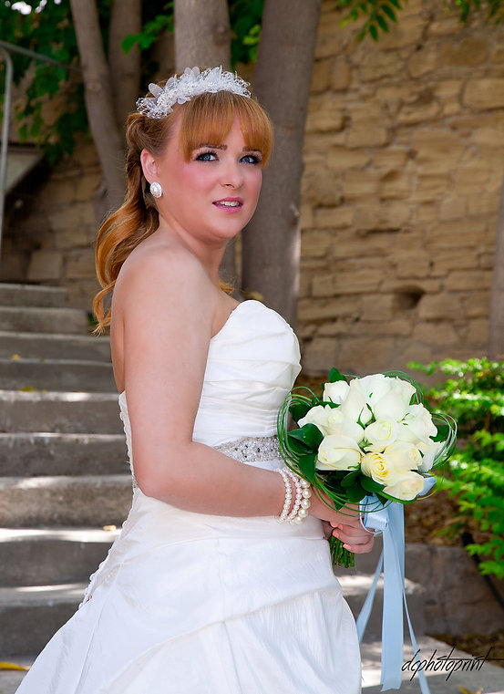 Close-up portrait of gorgeous beautiful bride in white dress with amazing hair style and make up, holding bouquet.  |  cyprus wedding photographer paphos, weddings photographer paphos