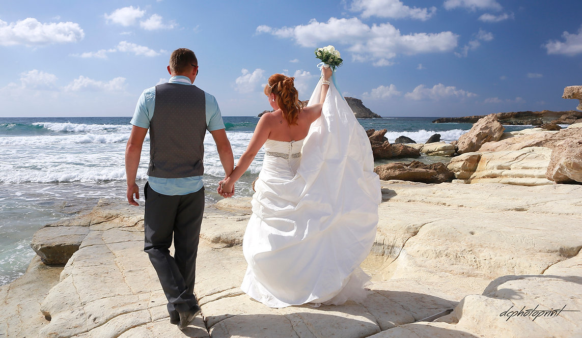 Elegant smiling bride and groom walking on the beach of Paphos | amous pics wedding photographers paphos, famous wedding photographer photos in Paphos