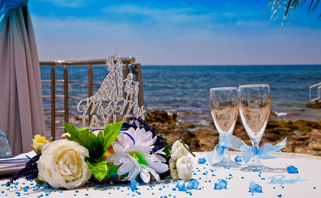Soft focus of beautiful flower decoration in the wedding celebration outdoors, the magnificent Mediterranean Sea in the background | civil paphos wedding photography, marriage at city hall paphos,cyprus Geroskipou sunset images wedding photography