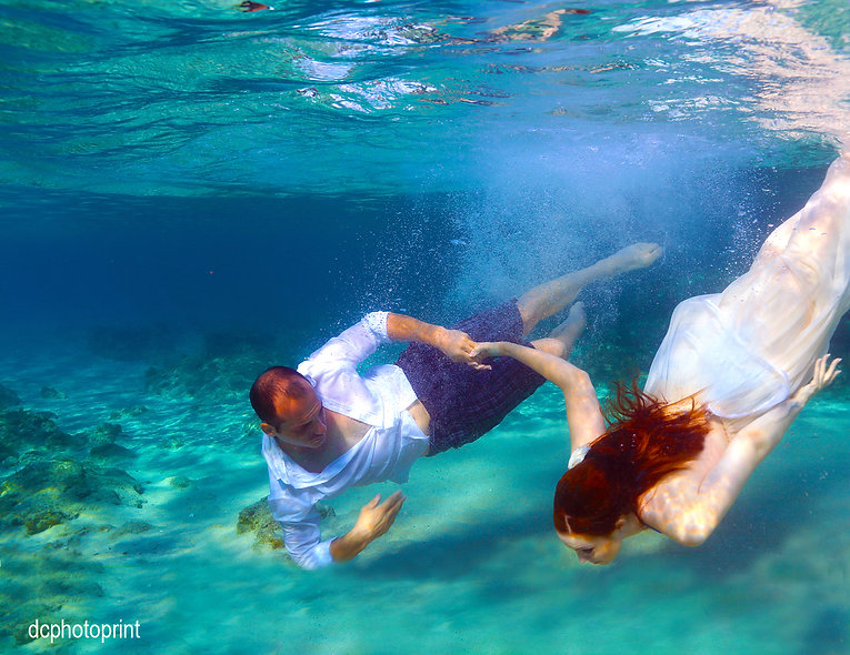 Trash the dress. Bride and groom are taking a swim underwater. Bride wears wedding dress | Perfect wedding pictures cyprus