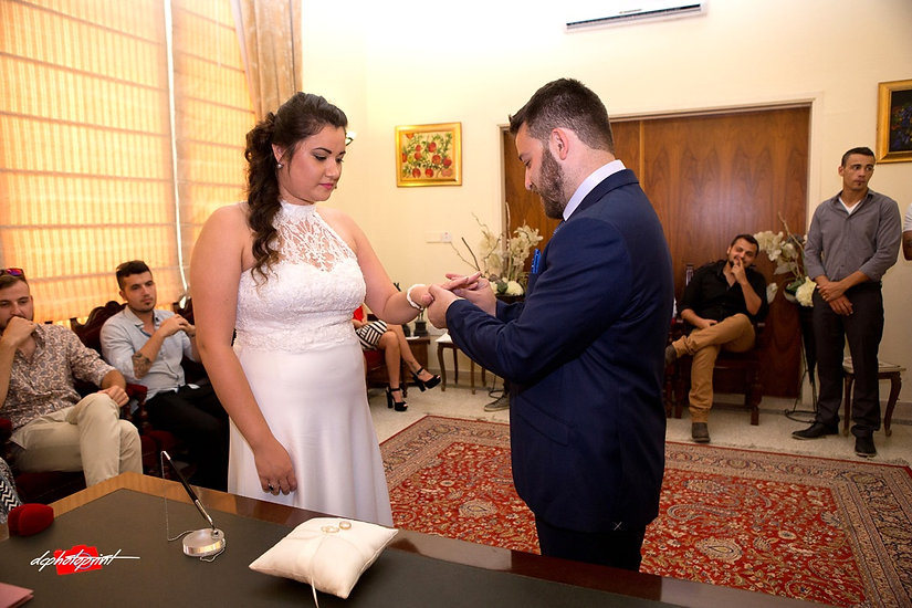 Alex Put the Wedding Ring on Karina Slo in the wedding ceremony | cyprus wedding photographers paphos, wedding photography paphos