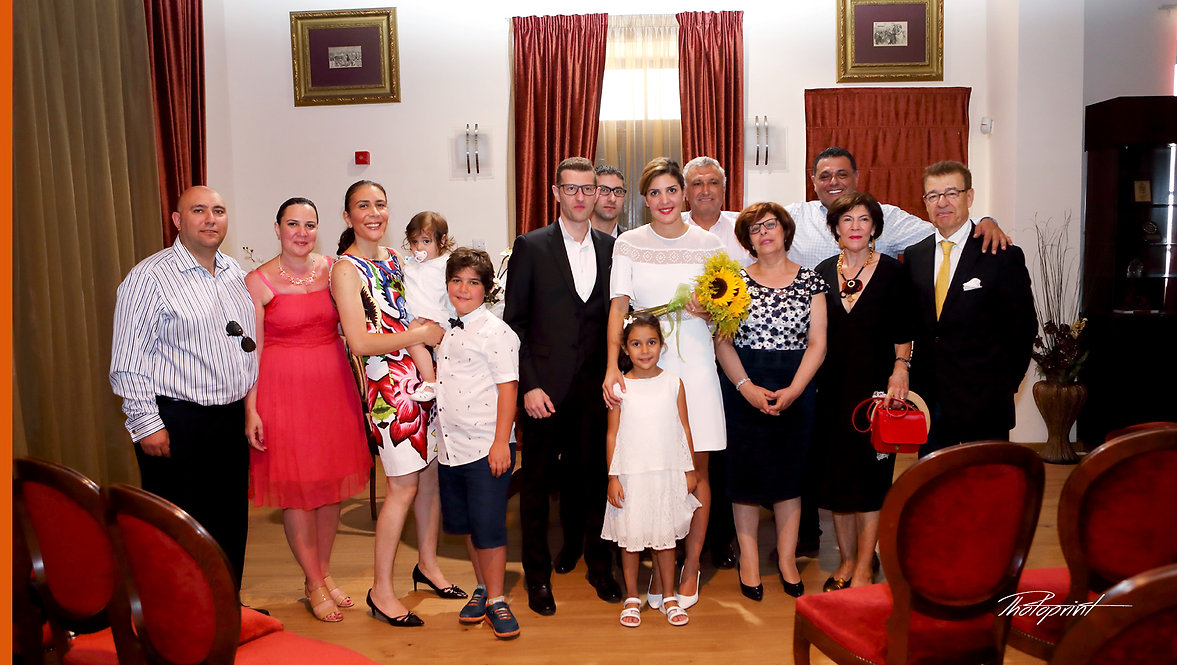 family, guests, bride and groom wedding photo after the wedding ceremony at Larnaca Municipality | cyprus wedding larnaca photographers for hire, cyprus wedding larnaca photographers near
