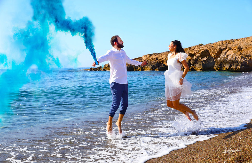 Beautiful and gentle wedding photo session outdoors of the elegant couple, Mediterranean Sea on background