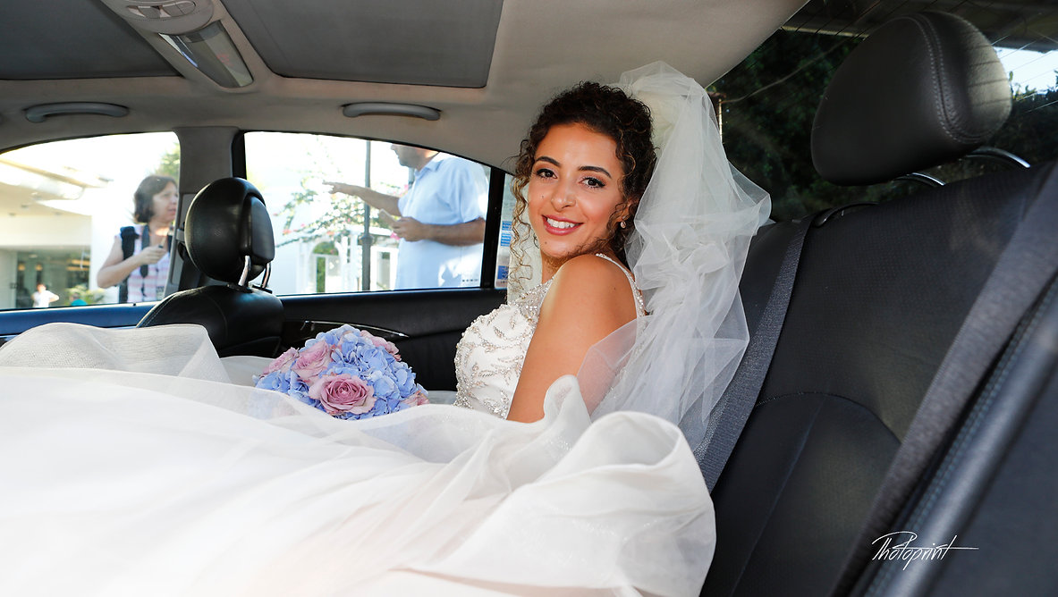 the bride is ready at the limousine for the wedding in the church | larnaca wedding photographer cost, larnaca cyprus wedding photographers cheap, larnaca wedding photography packages