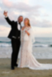 Beautiful and gentle wedding photo session outdoors of the elegant couple (bride in a white dress with veil holding a bouquet and groom in the classic tuxedo costume) | Hotel weddings in Larnaca cyprus, photoprint cyprus weddings in Larnaca, villa weddings in larnaca