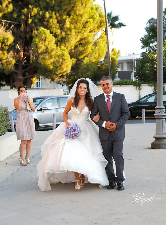 The bride coming with her father for the wedding ceremony | Beach wedding reception venue in Larnaca | photoprint cyprus, beach weddings larnaca,Beach Weddings Packages larnaca