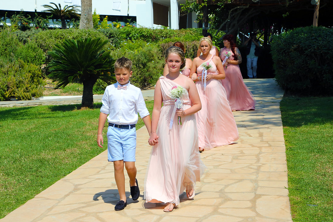 Portrait of beautiful little boy and girls in wedding dresses walk for the wedding ceremony | Bespoke wedding pictures in cyprus