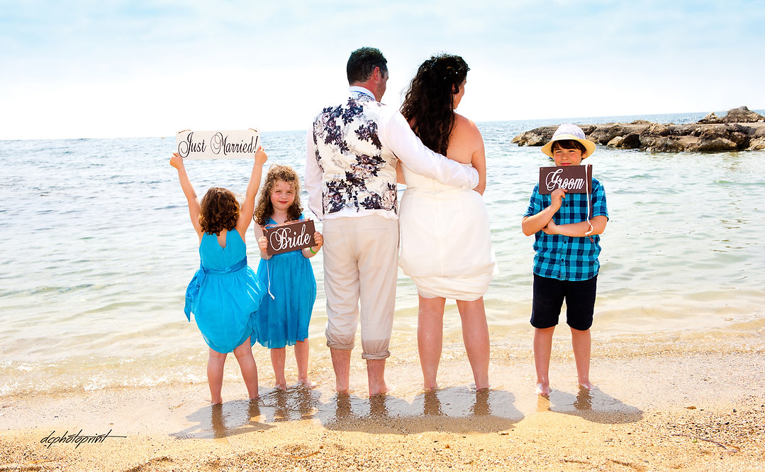 Romantic bride and groom having fun at the seaside with their children | wedding photographers Geroskipou cyprus, wedding photographers Geroskipou, cyprus wedding photography best prices