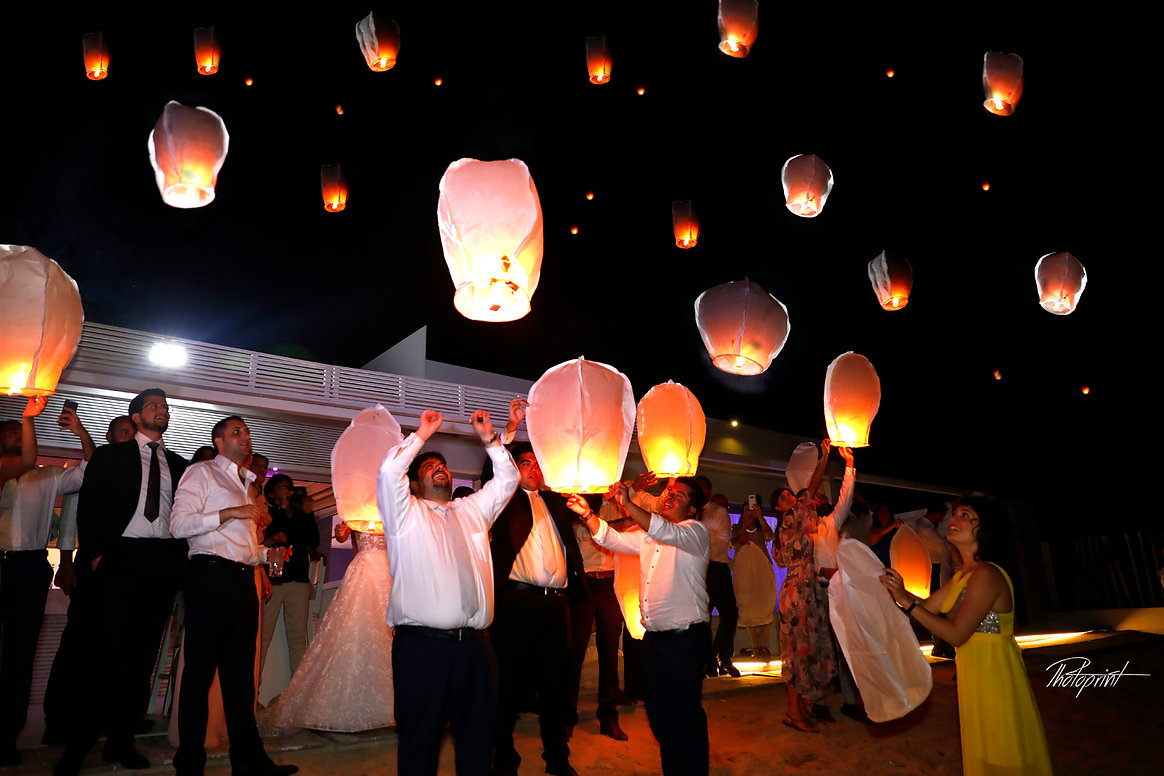 Wedding guests prepared the Hot air balloons for lift off at the wedding party  |  getting married in Ayia napa for best photography, best wedding photographer in ayia napa cyprus