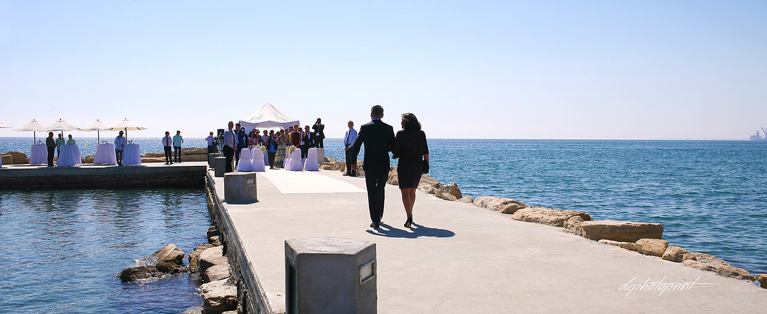 The groom comes accompanied by his mother in the marriage. τhe magnificent Mediterranean Sea in the background | cyprus limassol photographer paphos, limassol best wedding photographer photography