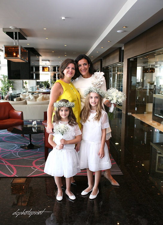 bride with guest, and two beautiful little flower girls in wedding dresses  before the wedding at Amathus Beach Hotel, cyprus | civil limassol wedding photography, wedding limassol photographers