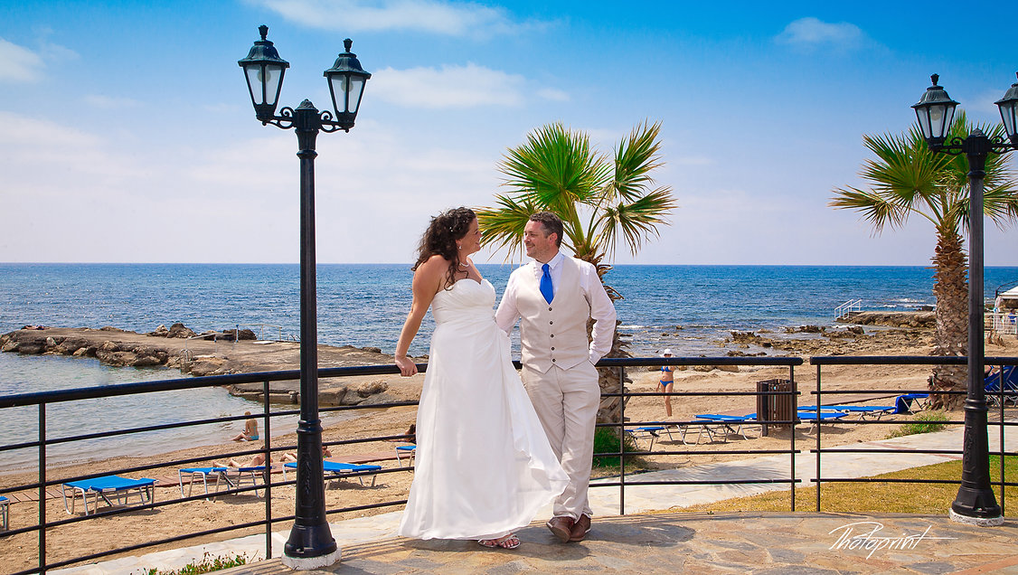 Picture of Elegant beautiful Just married couple romantic on the beach Kefalos tourist village paphos | Paphos best wedding photography photographer, paphos beach hotel wedding photography, civil paphos wedding photography