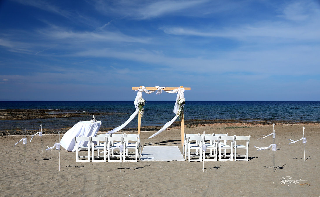 Beautiful Mediterranean beach ( Ayia triada protaras ) with decorated wedding pergola with and white materials prepared for ceremony | ceremomy, beach, wedding