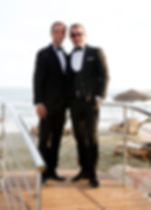 The groom together with his brother outdoors at the park, the magnificent Mediterranean Sea in the background | wedding packages in larnaca, cyprus wedding photographer paphos,Larnaca Best wedding photos cyprus