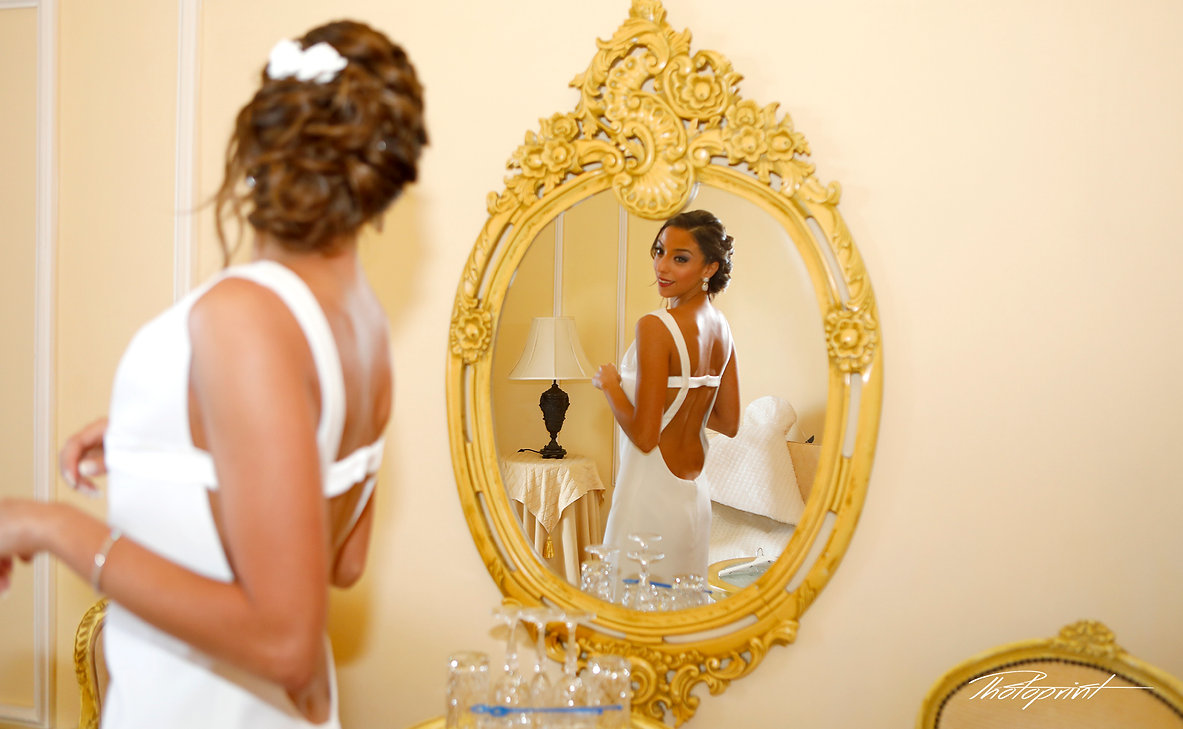 Bride in white wedding dress looking in mirror |  wedding photography package cyprus, civil Larnaca wedding photography, cyprus professional wedding photographers, city hall marriage at Larnarnaca