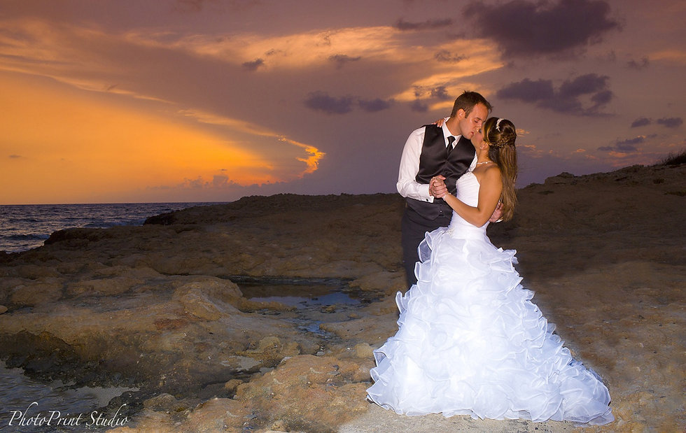 Bride and Groom,Kissing at Colorful sunset over the Beautiful Mediterranean sea at ayia napa, cyprus  | Stunning photography