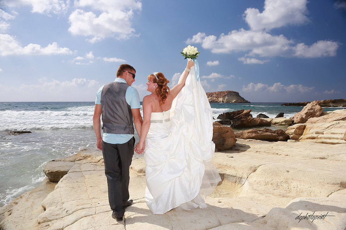 Picture of Elegant beautiful Just married couple romantic on the sea at Paphos | professional wedding photos photographers in Paphos | photo photography in paphos cyprus, professional wedding photos photographers in Paphos