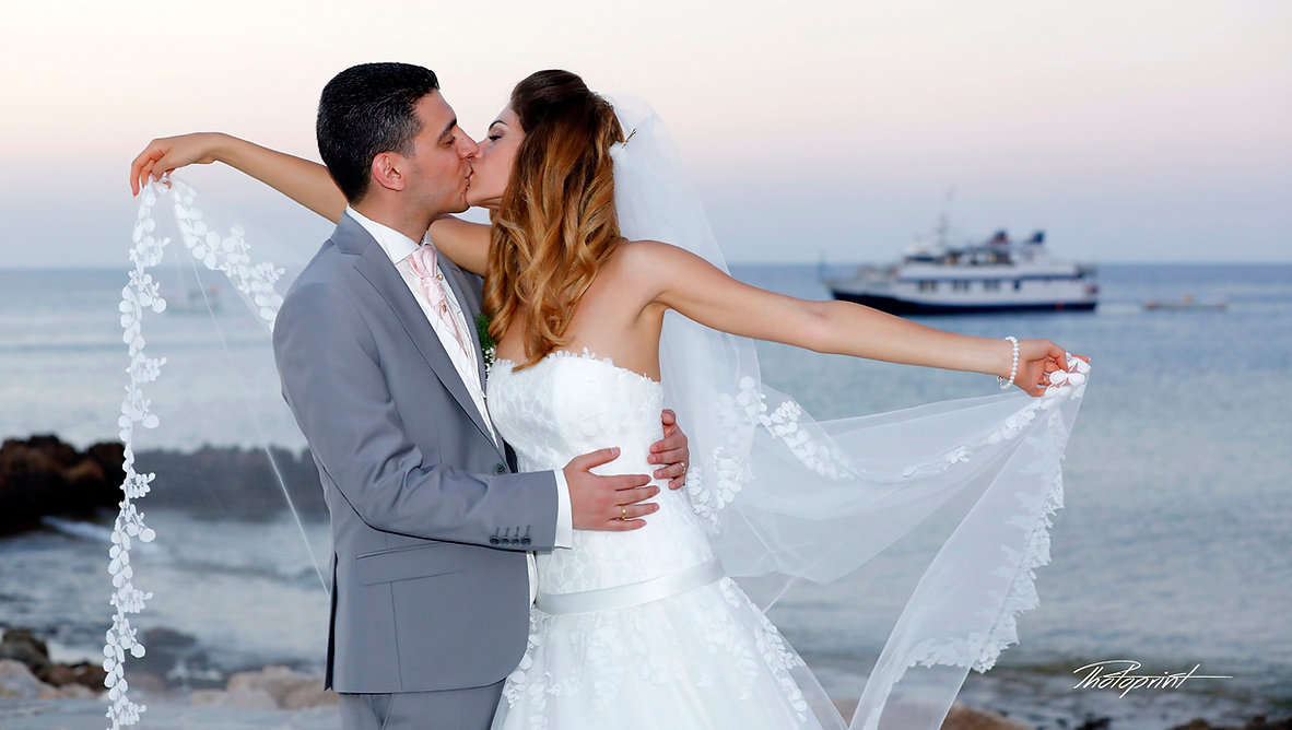 Romantic Bride And Groom kissing at wedding reception | cyprus sunset images wedding photography protaras, wedding protaras photographers, photographers in protaras