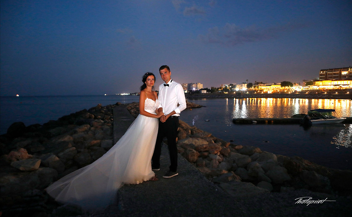 Picture of romantic young couple having a walking on the sea shore by the nigth at Protaras | Protaras budget wedding photography cyprus, cyprus wedding photographers prices protaras