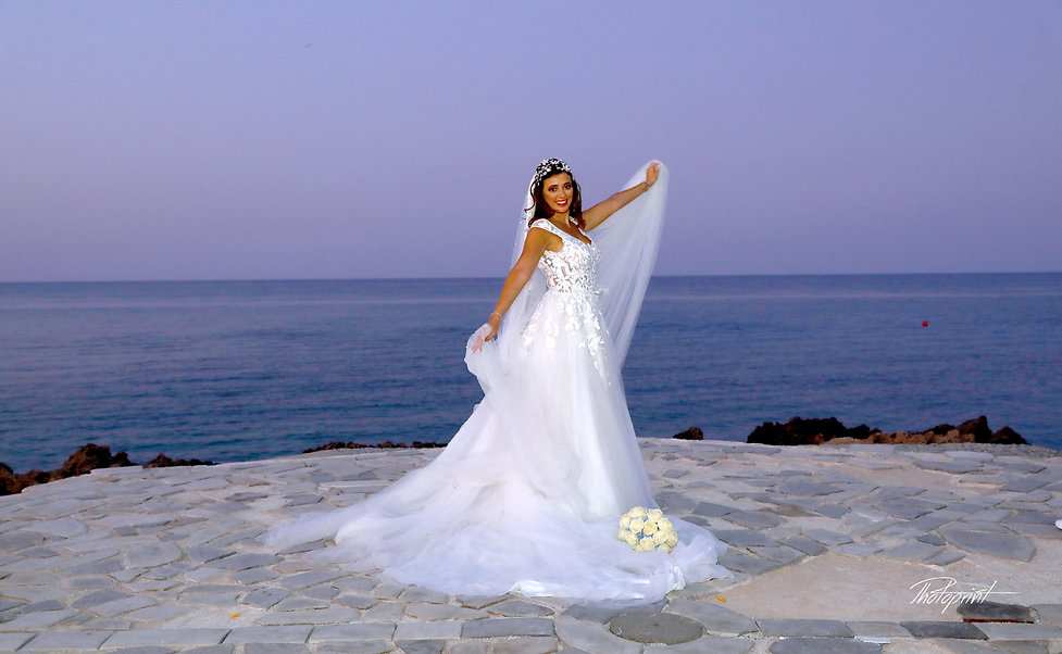 Bride by the beach at night after the wedding | photography prices cyprus