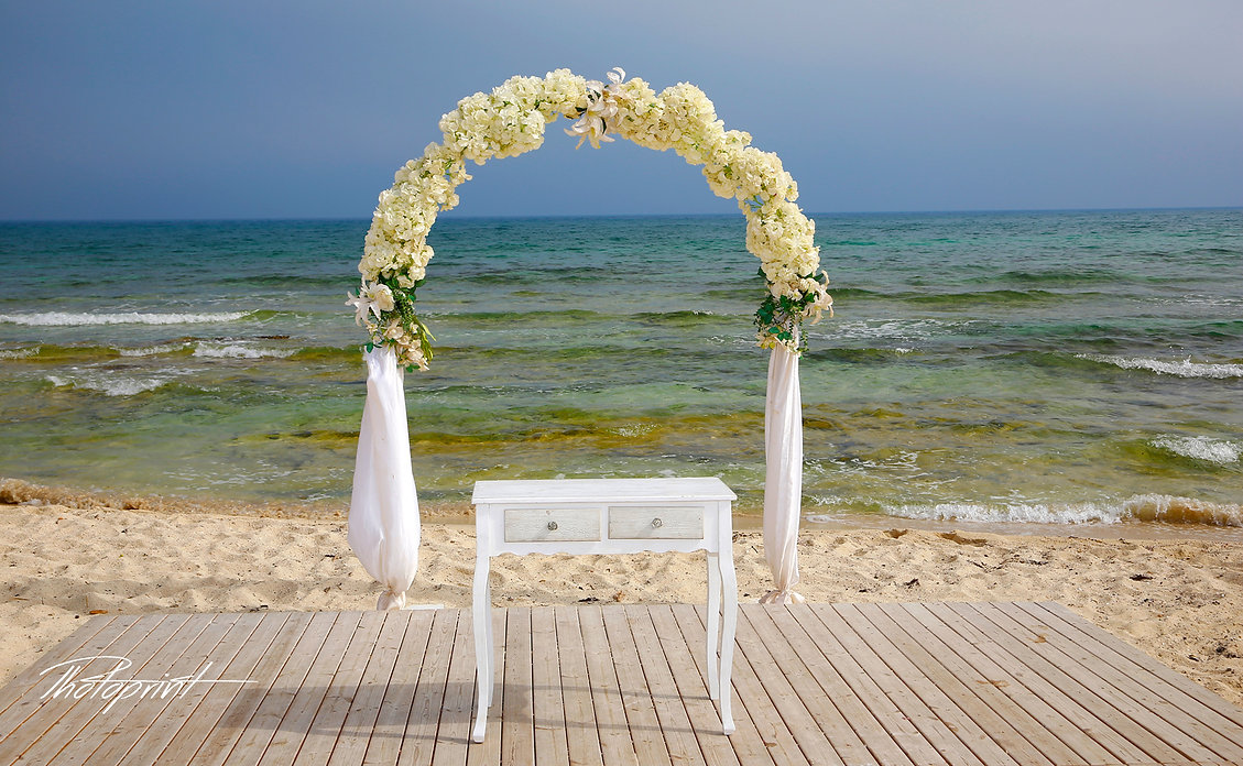 Wedding arch decorated with flowers on tropical sand beach, outdoor at ayia thekla, Sirens beach cyprus | english wedding photography ayia thekla, Sirens beach, cyprus sunset images ayia Thekla wedding photography, wedding photo ideas ayia Thekla cyprus