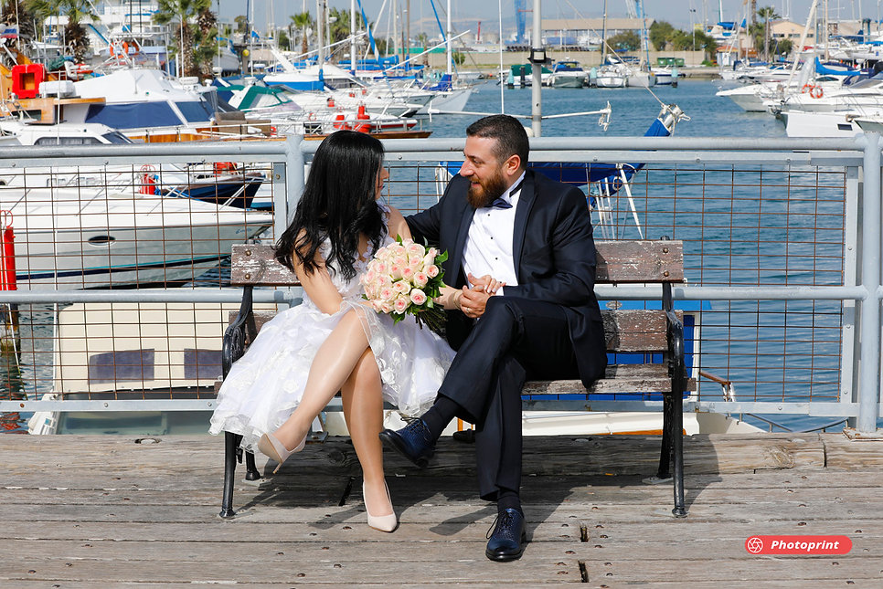 Beautiful and gentle wedding photo session outdoors of the elegant couple (bride in a white dress holding a bouquet )
