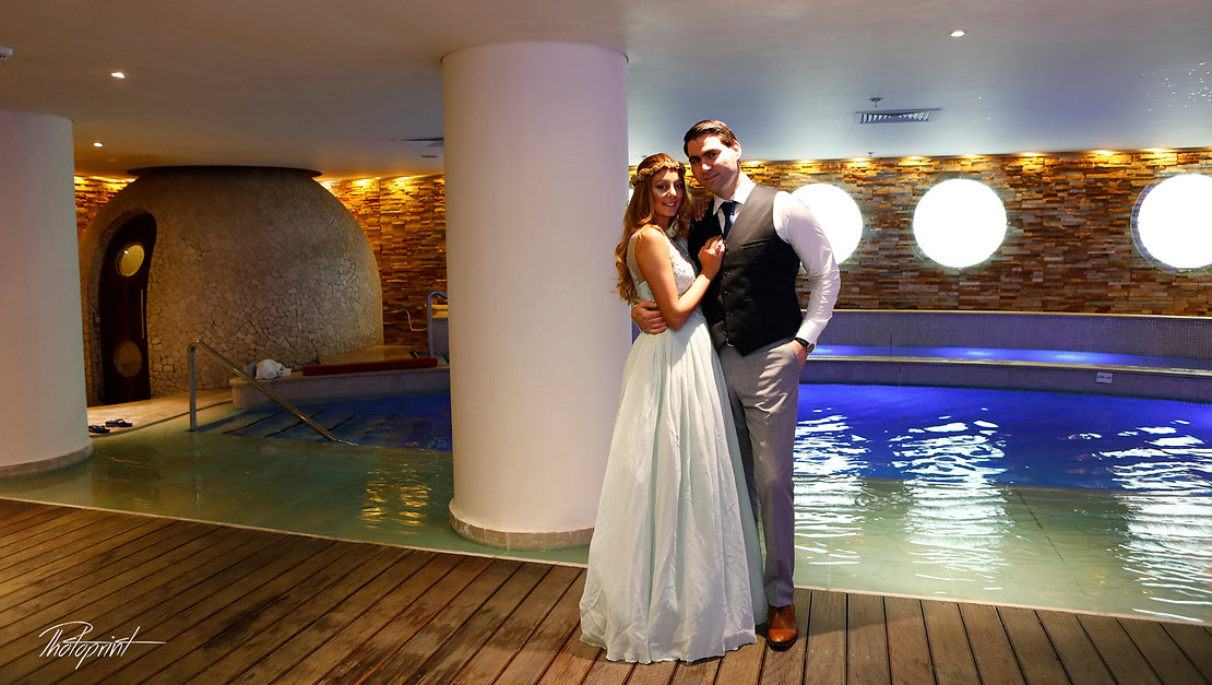 Bride and groom at the Hilton Park pool's | civil marriage in nicosia cyprus,nicosia budget wedding photographers, budget wedding nicosia photographer