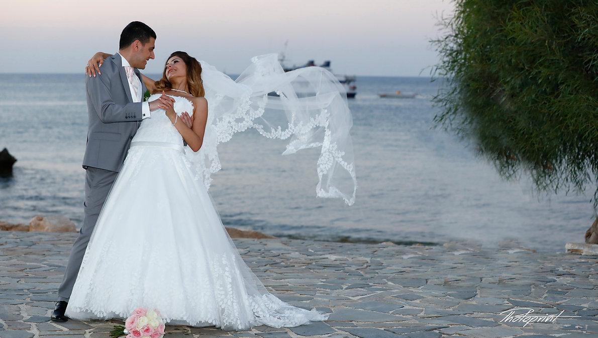 Married Couple Kissing Sunset Beach Wedding   civil protaras wedding photography,  protaras  best wedding photos cyprus, protaras  best wedding photographer