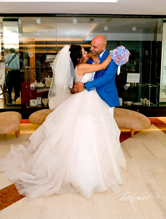 Handsome young groom kissing his wife | arnaca weddings cyprus,  larnaca civil weddings photographers, larnaca civil wedding photographer