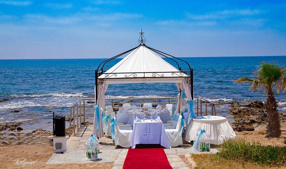 Romantic Kiosk for their wedding celebration outdoors decorated with flowers on Mediterranean sand beach - wedding portfolio