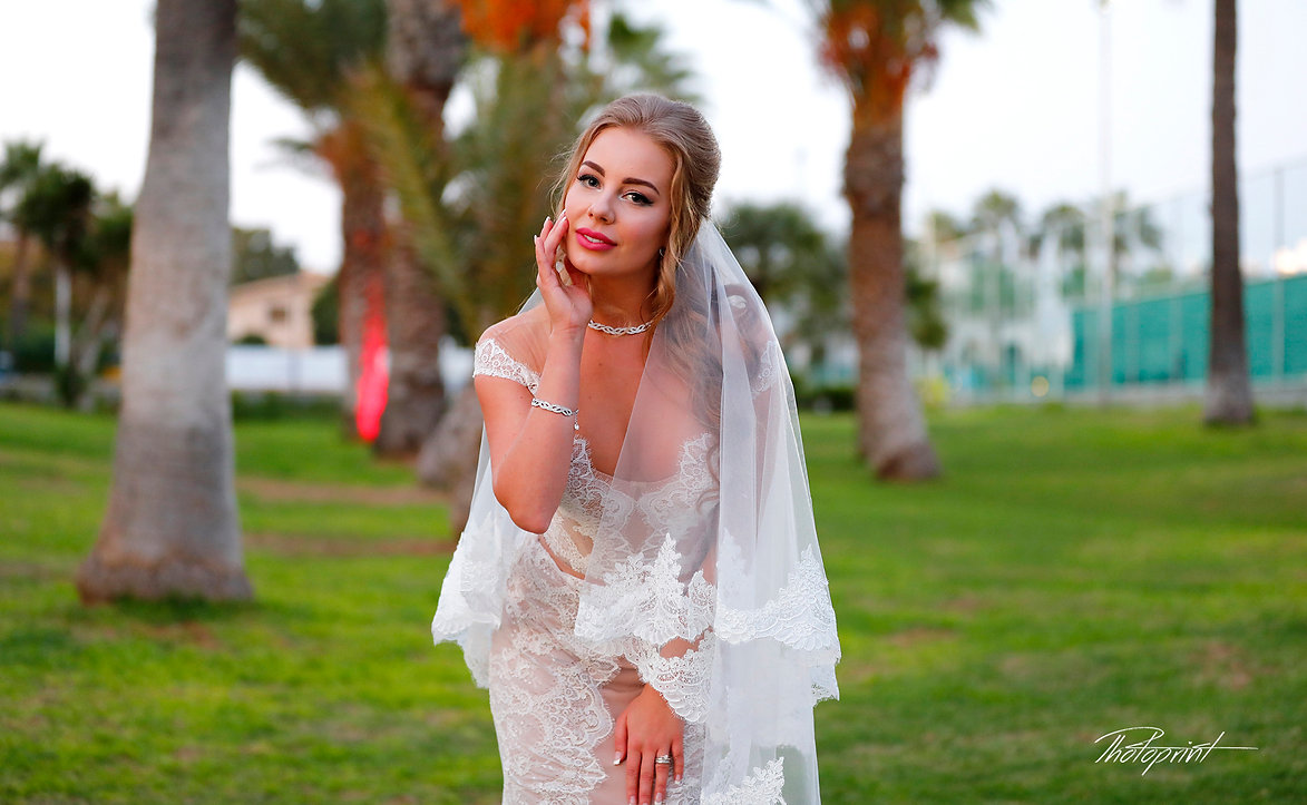 Gorgeous bride in wedding dress with bouquet of flowers posing outdoors at Golden Bey Beach Hotel in Larnaca  |  lebanon wedding photographers Larnaca, lebanese wedding photography bride getting ready, best wedding photographers in lebanon
