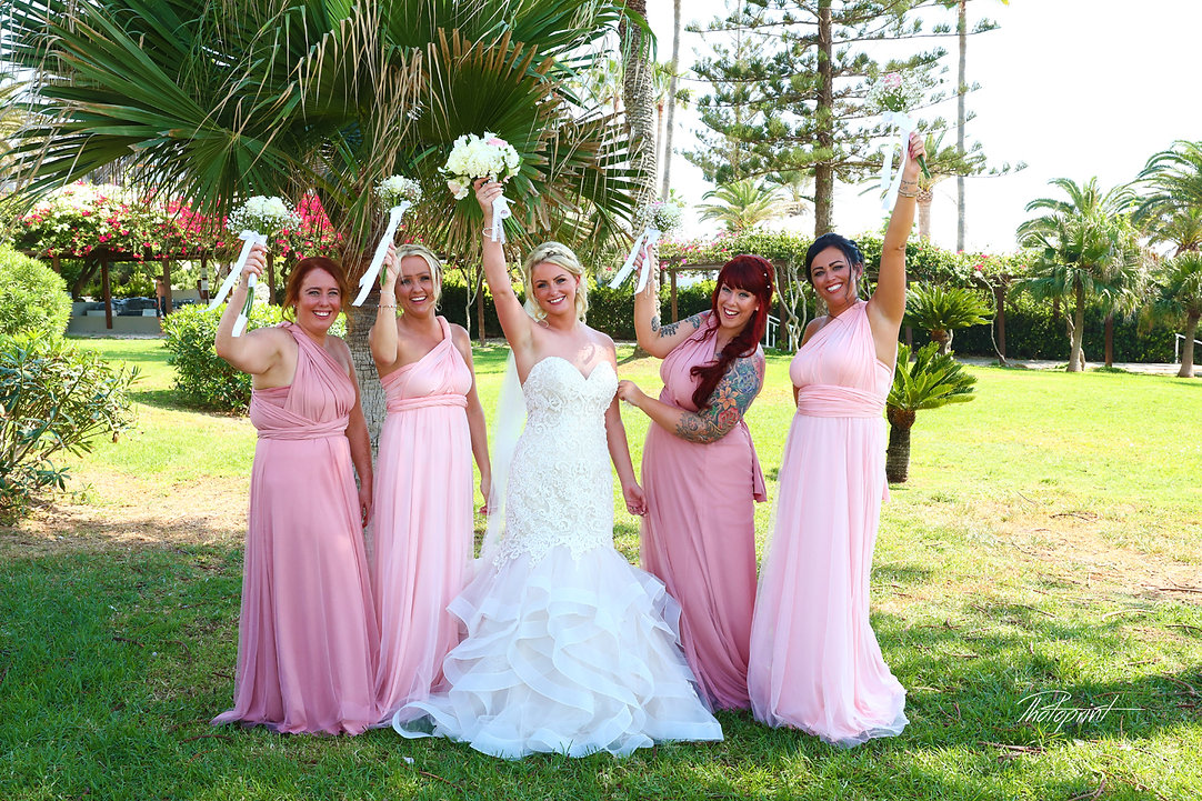 Bride and bridesmaids in Nissi beach Resort in ayia napa | cyprus sunset images wedding photography ayia napa