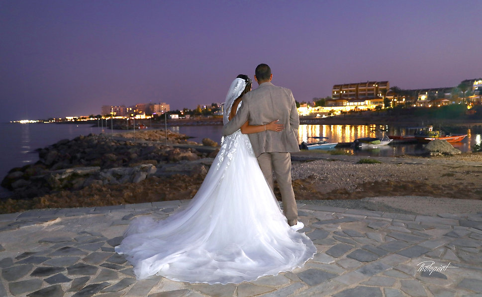 Just married couple on walking on the beach at night after the wedding | wedding photographer cyprus