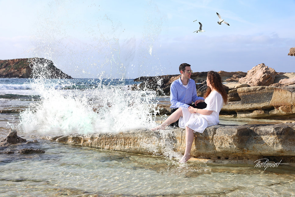 Couple in love sitting near in  Blue beach of Paphos